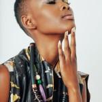 Flaviana Matata bog necklace and short natural hairstyle
