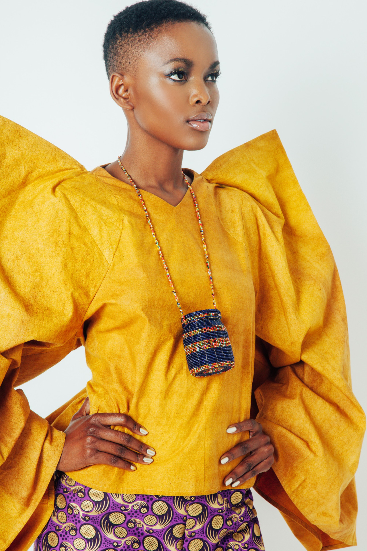 Flaviana Matata nice african fashion style, necklace and short natural hairstyle