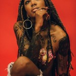 Afro punk style, tattoo, locs hairstyle, bull nose ring