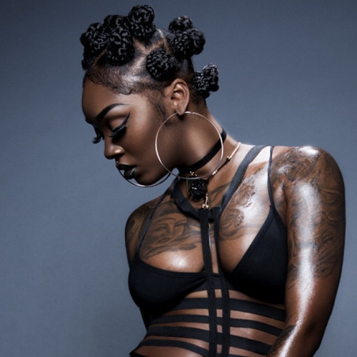 Bantu knots hairstyle, big earrings and tattooes