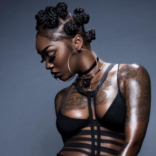 Bantu knots hairstyle, big earrings and tattooes