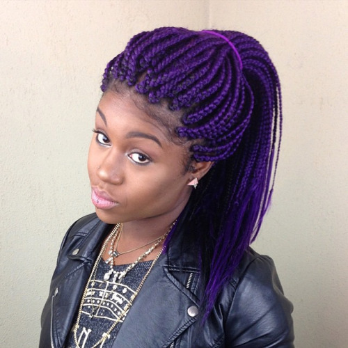 Purple box braids hairstyle and leather jacket