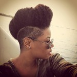 Nice side shaved natural hairstyle and sunglasses