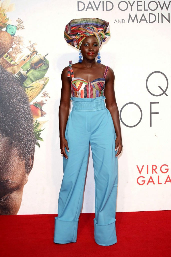 Lupita Nyong'o nice blue large pants and colorfull headscarf for Queen of Katwe