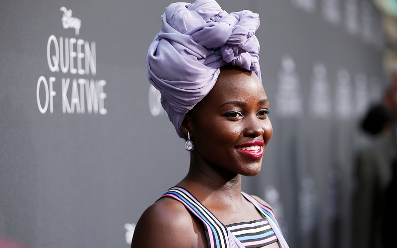 "Lupita Nyong'o nice purple headscarf during the Los Angeles premiere of ""Queen of Katwe"""
