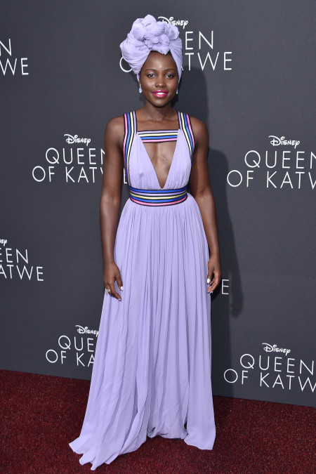 "Lupita Nyong'o purple dress and headscarf during premiere of ""Queen of Katwe"""