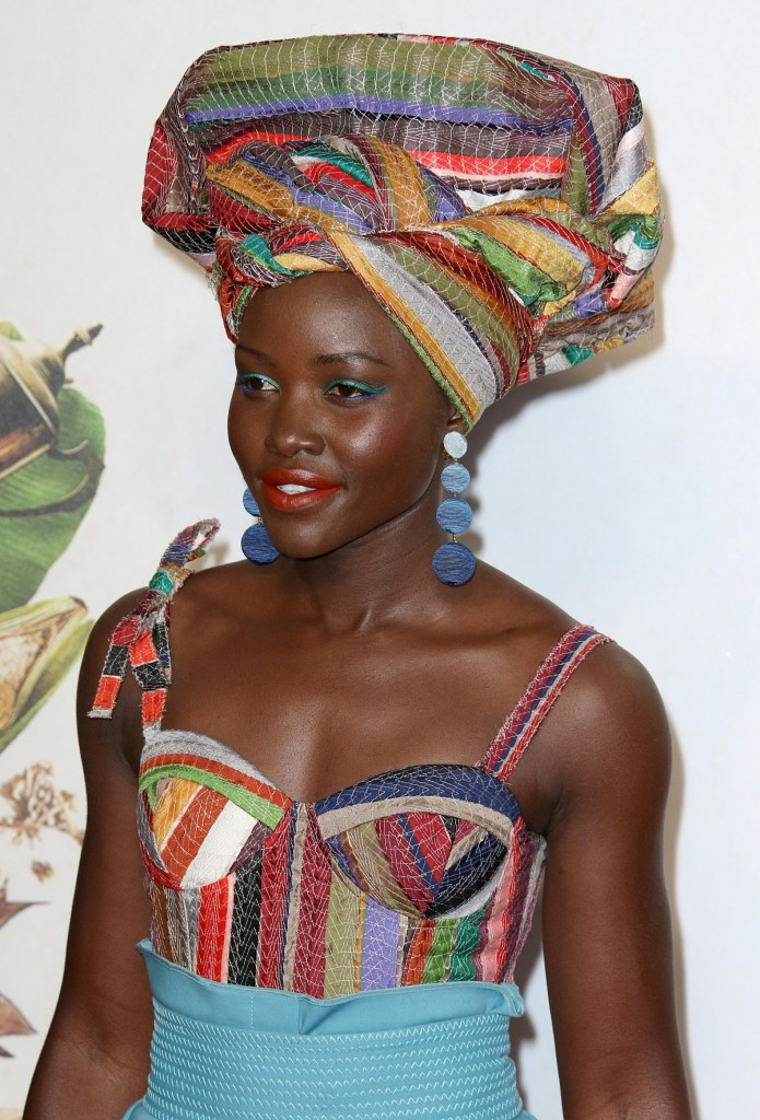 "Lupita Nyong'o wonderful headscarf adn earrings for ""Queen of Katwe"""